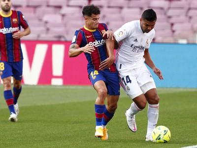 Casemiro a Philippe Coutinho v súboji o loptu