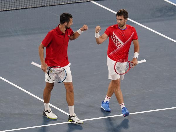 Chorvátski tenisti Nikola Mektič a Mate Pavič