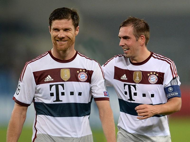 Xabi Alonso a Philipp Lahm