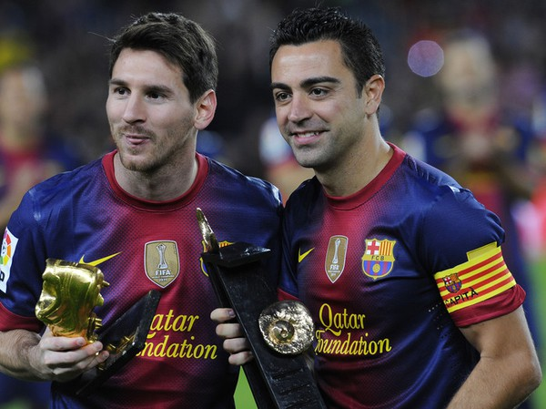 Messi a Xavi
